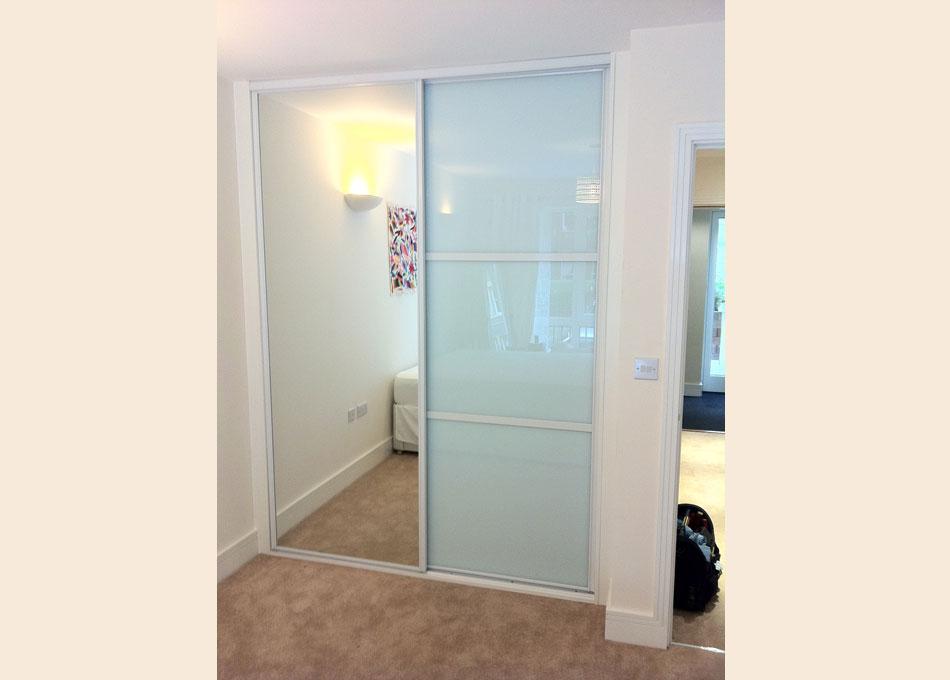 White frame mirror and white glass