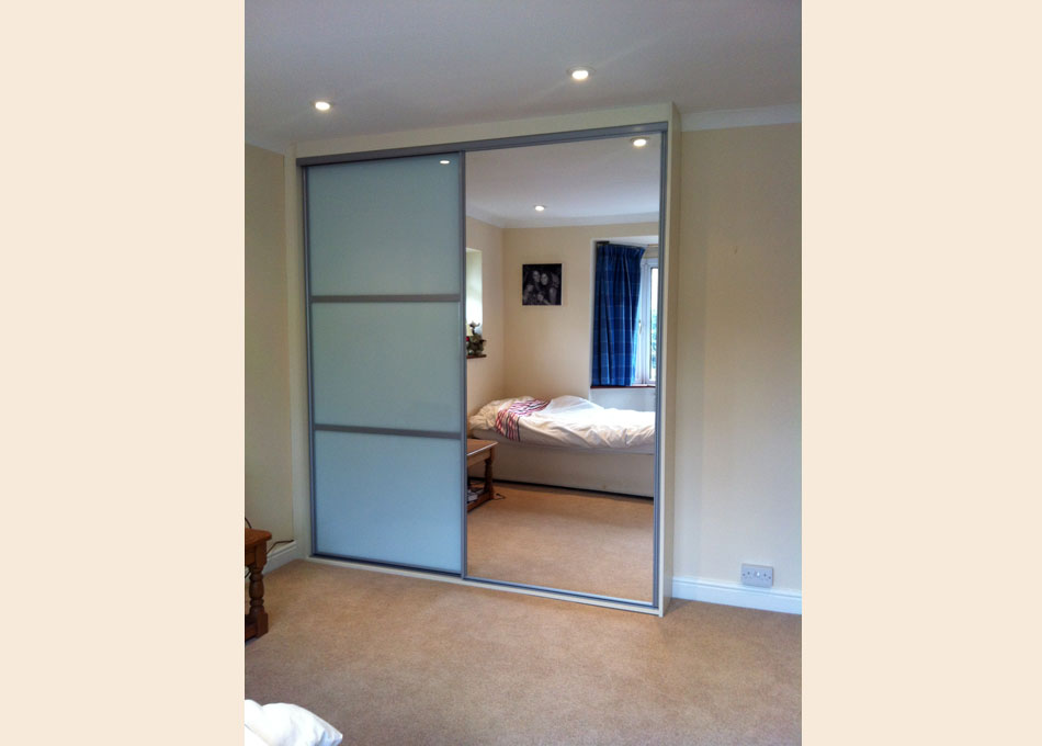 Silver frame mirror and white glass