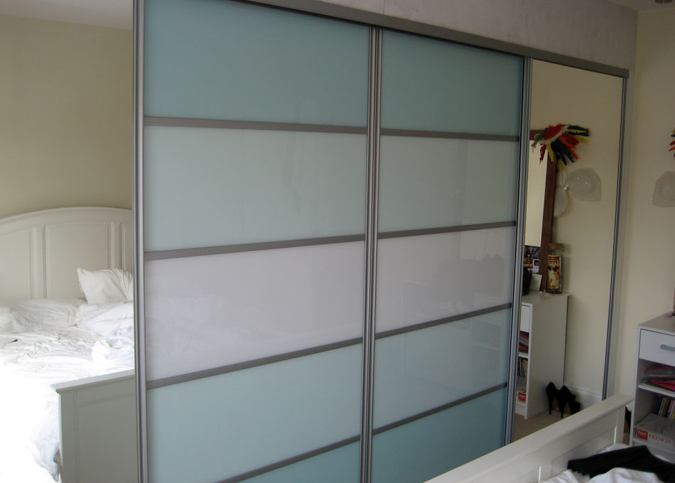 Silver frame mirror and multi-panel doors