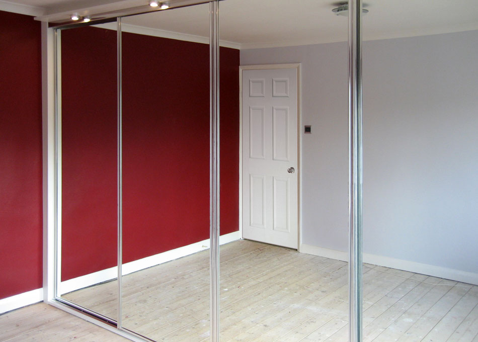 Mirror wardrobe with chrome frame