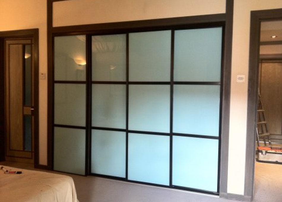 Oriental wardrobe black frame and pastel aqua glass