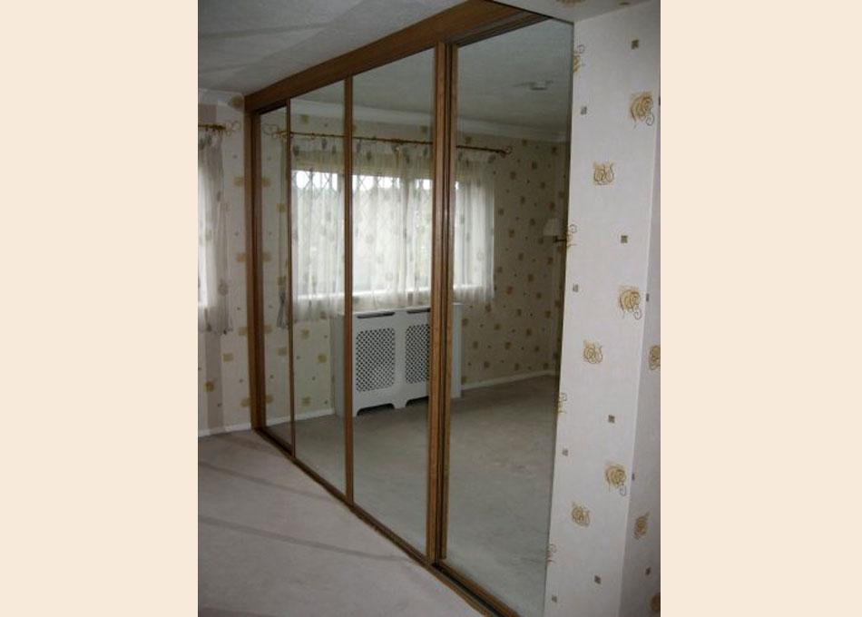 Mirror wardrobe with oak frame